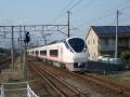 An E657 train set passing through Natori Station.